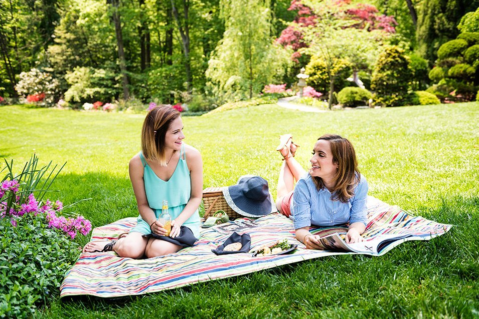 Photo of two women having a picnic on the lawn in Dupont, DC